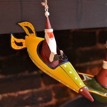 Original_santa-riding-yellow-rocket-xmas-decoration