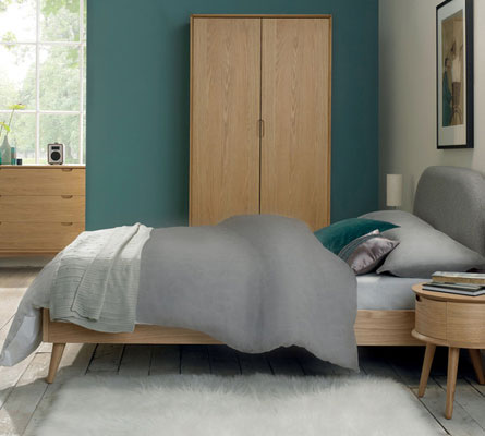 Awesome The oak theme continues with a tall chest of darers a wide chest of dealers and a stylish double wardrobe Even better is the nightstand with angled legs